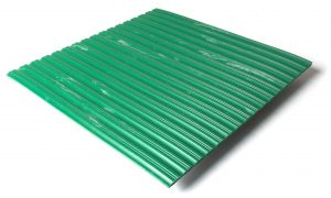 Standard transit flooring in marbled green, ribbed