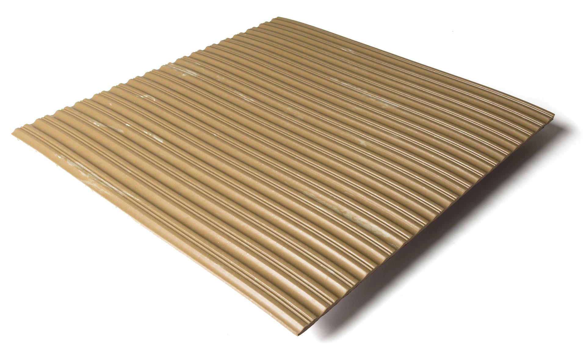 Standard transit flooring in marbled tan, ribbed