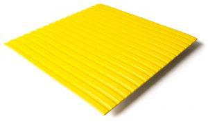 Standard transit flooring in yellow, ribbed
